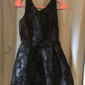 Short black junior dress.